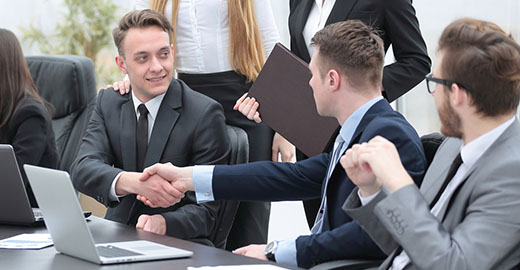 business people shake hands after negotiating a deal